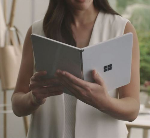 Surface Neo held like a book
